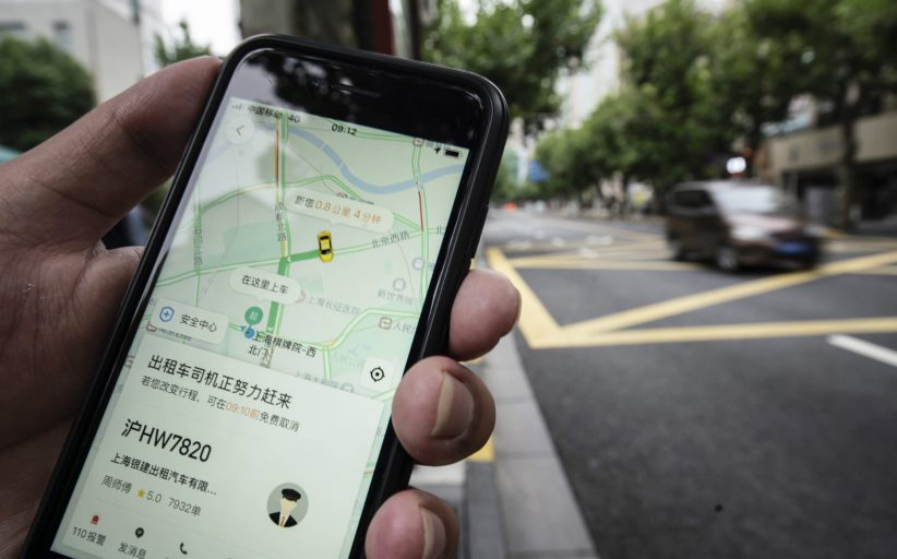 Didi shares pare off initial double-digit gains in IPO